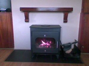 Teak Timber Mantel above lighting Stove