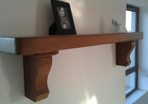 Beautiful Teak Mantel with Dark Stain in Place