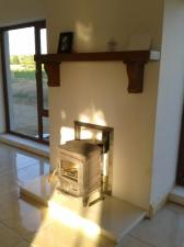 Teak Mantel with Support Corbels in New Home (Dark Stain)